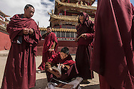 For a story by Ed Wong : CHINASICHUAN - Two journals in Sichuan<br /> Larung Gar, Sertar, Sichuan, China<br /> October 8th, 2016<br /> A group of Buddhist monks have stopped to check religious books on sale on a street of Larung Gar, an influential Buddhist academy. <br /> Gilles Sabri&eacute; for The New York Times