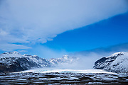 Blue sky over glacial tongue of Svinafellsjokull glacier, an outlet glacier of Vatnajokull, the largest ice cap in Europe, Iceland
