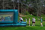 Participants of the O'Bleness System Race for a Reason Mud Run go through the inflatable obstacle course before they make it up the hill to the old Army ROTC training course at the Ridges, Saturday, April 27, 2013. The Mud Run was a four-mile run up to the ROTC Course, through the Radar Hill Trail and back to Tail Great Park across from Peden Stadium. Race for a Reason, Race 4 A Reason, Annual Events, Events, Students, Faculty & Staff