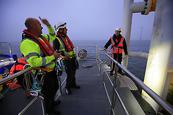 UK ENGLAND NORFOLK SHERINGHAM SHOAL 25SEP13 - Crew and engineers get ready to transfer to a wind turbine from the bow of the Tidal Transit vessel Tia Elizabeth at the Sheringham Shoal wind farm in the North Sea off the Norfolk coast, England.<br /> <br /> <br /> <br /> jre/Photo by Jiri Rezac<br /> <br /> <br /> <br /> © Jiri Rezac 2013