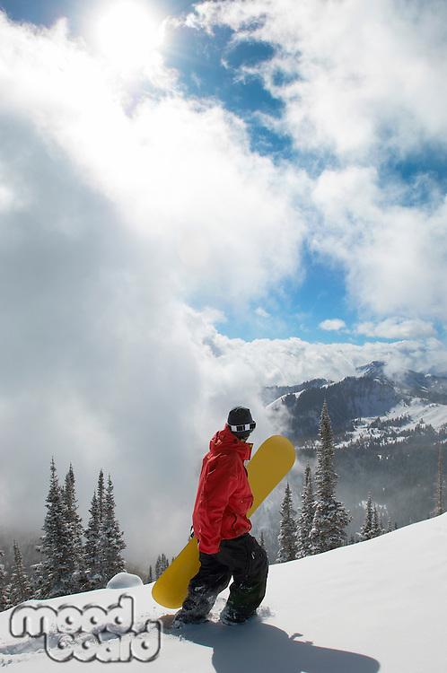 Snowboarder Hiking to Find Fresh Snow