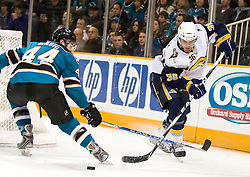 January 23, 2010; San Jose, CA, USA; Buffalo Sabres right wing Patrick Kaleta (36) is defended by San Jose Sharks defenseman Marc-Edouard Vlasic (44) during the first period at HP Pavilion. San Jose defeated Buffalo 5-2. Mandatory Credit: Jason O. Watson / US PRESSWIRE
