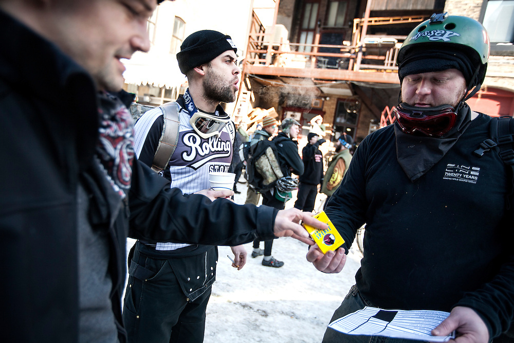 Left to right, Ryan Serafin, Chris Foreman and Ian Anderson figure out their routes before the start of the Stupor Bowl 17 bike race in Minneapolis February 1, 2014.