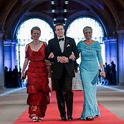 Princess Mabel, left, Prince Constantijn, center and Princess Laurentien, right, arrive for a dinner, at the invitation of Queen Beatrix, with members of the royal family and guests at the Rijksmuseum in Amsterdam, The Netherlands, on Monday night, April 29, 2013. HANDOUT/ROBIN UTRECHT