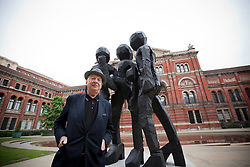 © Licensed to London News Pictures. 18/06/2013. London, UK. German artist Georg Baselitz is seen next to his sculpture 'Untitled' (2013) at the press view for its unveiling at the Victoria and Albert Museum in London today (18/06/2013). The sculpture, one of several made from wood and bronze by the artist over the last 30 years, is on display to the public in the museum's John Madejski Garden until the 8th of September 2013. Photo credit: Matt Cetti-Roberts/LNP