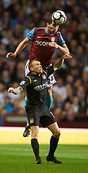 BIRMINGHAM, ENGLAND - Monday, October 5, 2009: Manchester City's Craig Bellamy and Aston Villa's Carlos Jimenez Cuellar during the Premiership match at Villa Park. (Pic by David Rawcliffe/Propaganda)