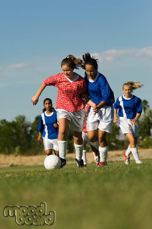 Girls (13-17) playing soccer