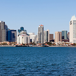 High resolution photo of San Diego skyline with waterfront downtown city buildings during the day accross San Diego Bay in Southern California.
