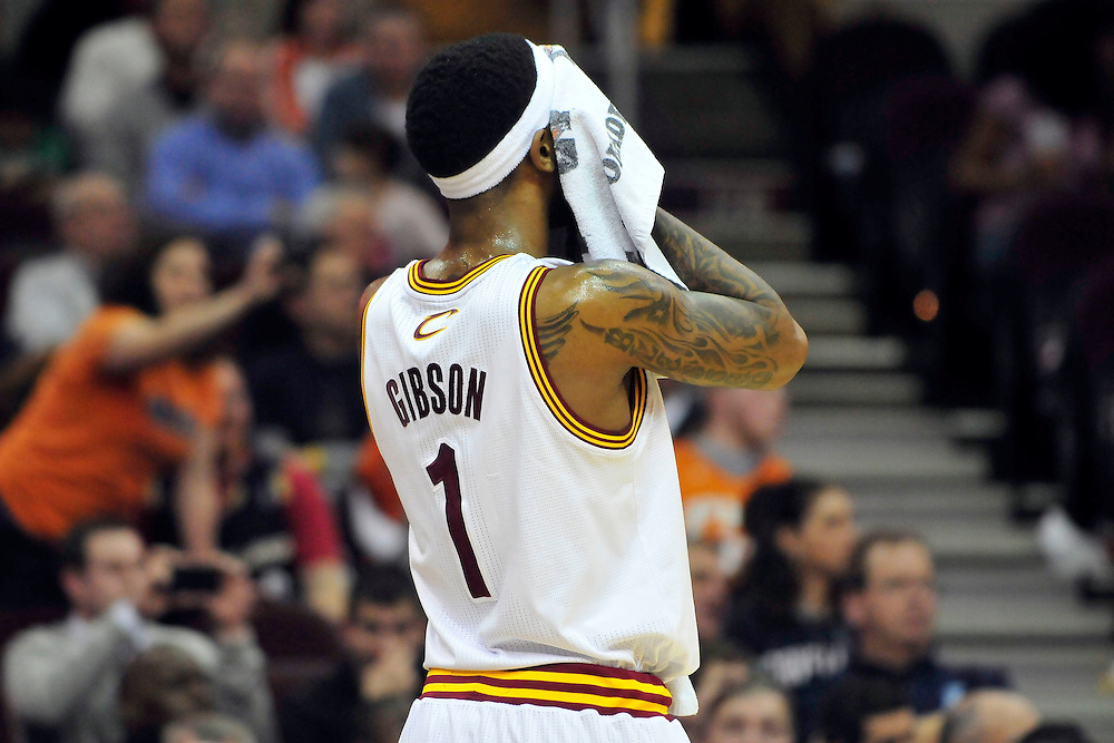 Jan. 19, 2011; Cleveland, OH, USA; Cleveland Cavaliers point guard Daniel Gibson (1) wipes sweat from his face during the fourth quarter against the Phoenix Suns at Quicken Loans Arena. The Suns beat the Cavaliers 106-98. Mandatory Credit: Jason Miller-US PRESSWIRE