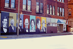 Portraits of famous people who made a mark on McLean County are painted on a building wall in downtown Bloomington - 2000