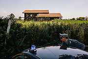Giuseppe Ciccarelli, an assistant to the general of the National Forest Service, parks at Villa di Briano, an illegal Mafia dumpsite that was excavated by authorities in 2013. The site was located on the edge of Casal di Principe, a Mafia stronghold.