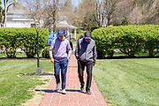 Justin Thomas, left, walks with his father, Mike, the PGA Master Professional at Harmony Landing Country Club, on their way to the check signing.<br /> Justin Thomas hosts the Strategic Communications / Justin Thomas Junior Championship presented by Phocus at Harmony Landing Country Club Friday, April 20, 2018, in Goshen, Ky. (Photo by Brian Bohannon)