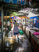 20 APRIL 2013 - BANGKOK, THAILAND:   A street scene in Talat Noi (Talat means Market, Noi means Small. Literally Small Market). The Talat Noi neighborhood in Bangkok started as a blacksmith's quarter. As cars and buses replaced horse and buggy, the blacksmiths became mechanics and now the area is lined with car mechanics' shops. It is one the last neighborhoods in Bangkok that still has some original shophouses and pre World War II architecture. It is also home to a  Teo Chew Chinese emigrant community.   PHOTO BY JACK KURTZ