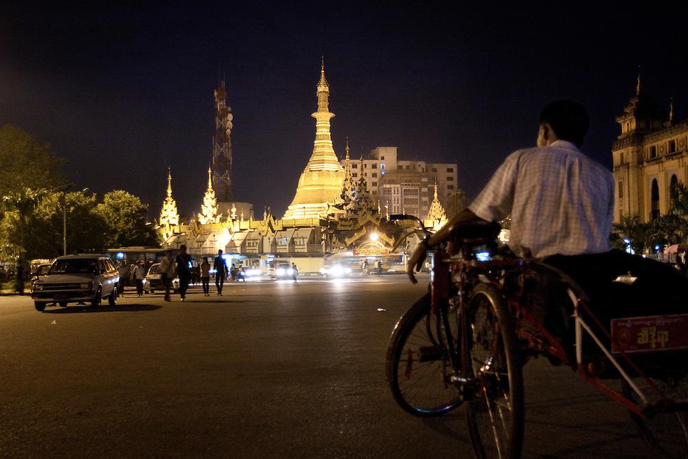A rickshaw by the Sule Paya in Yangon, Myanmar