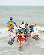 Paddlers Race Into The Finish, June 1, 2014 - OUTRIGGER : Hekili Great Barrier Reef Ocean Challenge, Cairns Airport Adventure Festival, Four Mile Beach, Port Douglas, Queensland, Australia. Credit: Lucas Wroe