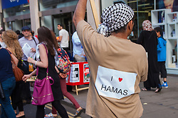 London, August 1st 2014. A Man displays hill love for Hamas as thousands of Palestinians and their supporters protest in London outside the Israeli Embassy following the collapse of the 72 hour ceasefire in the ongoing conflict.