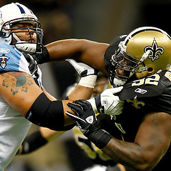 September 1, 2011; New Orleans, LA, USA; New Orleans Saints defensive tackle Shaun Rogers (92) rushes against Tennessee Titans center Leroy Harris (64) during the first quarter of a preseason game at the Louisiana Superdome. Mandatory Credit: Derick E. Hingle