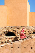 Visitors admire architecture at the El Badi Palace, Marrakesh, Morocco, 2016–04-22.<br /> <br /> The El Badi Palace and sunken gardens are a short walk from Bahia, within the old, towering Medina walls of the Mellah. <br /> <br /> Commissioned by the Arab Saadian sultan Ahmad-al-Mansur and completed in 1593, the complex took 25 years to build and is considered to be some of the finest examples of Saadian architecture in Moroco. <br /> A ruined palace, the site is often being renovated and restored, but remains to be many peoples favourite Marrakesh palace experience.