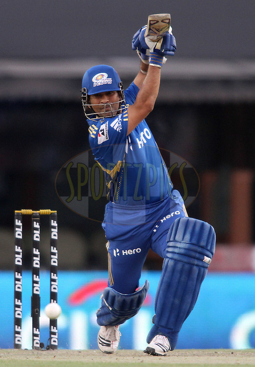 Sachin Tendulkar of the Mumbai Indians straight drives a delivery during match 33 of the the Indian Premier League (IPL) 2012  between The Kings X1 Punjab and The Mumbai Indians held at the Punjab Cricket Association Stadium, Mohali on the 25th April 2012..Photo by Shaun Roy/IPL/SPORTZPICS