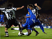Photograph: Scott Heavey.<br />Chelsea v Besiktas JK. UEFA Champions League Group G. 01/10/2003.<br />Jimmy Floyd Hasselbaink is taken down in the box in the dying minutes.