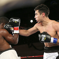 Omar Albanil (Right) fights Quincy Brown during a Telemundo boxing match at the A La Carte Pavilion  on Friday, August 1, 2014 in Tampa, Florida. (AP Photo/Alex Menendez)