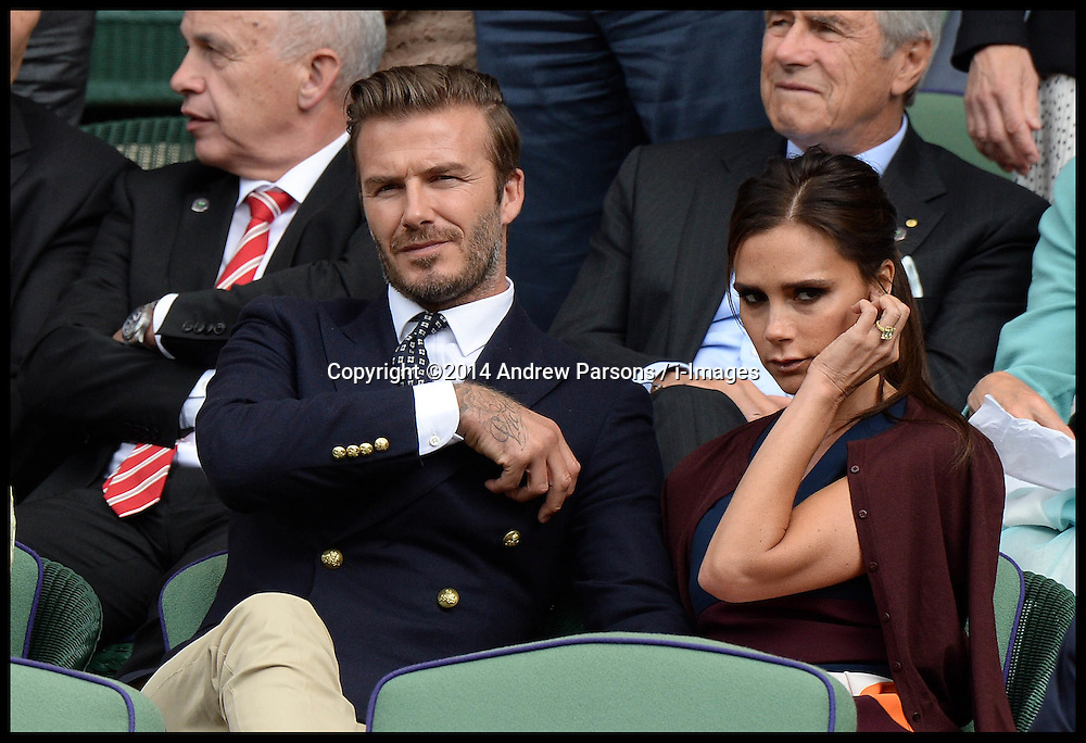 Image ©Licensed to i-Images Picture Agency. 06/07/2014. London, United Kingdom. Victoria and David Beckham watch the Mens 2014 Wimbledon final from the Royal Box between Rodger Federer and Novak Djokovic  on Centre court.  Picture by Andrew Parsons / i-Images