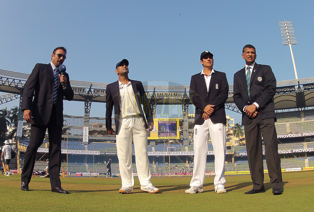 Mahendra Singh Dhoni - Captain of India and Alastair Cook - Captain of England at the toss during day 1 of the 2nd Airtel Test match between India and England held at the Wankhede Stadium in Mumbai, India on the 23rd November 2012...Photo by Ron Gaunt/ BCCI/ SPORTZPICS..Use of this image is subject to the terms and conditions as outlined by the BCCI. These terms can be found by following this link:..http://www.sportzpics.co.za/image/I0000SoRagM2cIEc