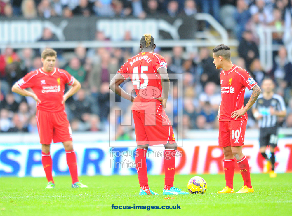 Liverpool players look dejected after Ayoze Perez of Newcastle United (not pictured here) scored a decisive goal during the Barclays Premier League match at St. James's Park, Newcastle<br /> Picture by Greg Kwasnik/Focus Images Ltd +44 7902 021456<br /> 01/11/2014