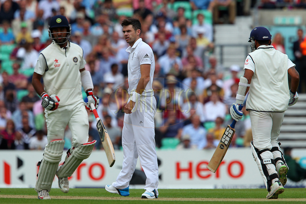 James Anderson of England looks on as the runs are made during day one of the fifth Investec Test Match between England and India held at The Kia Oval cricket ground in London, England on the 15th August 2014<br /> <br /> Photo by Ron Gaunt / SPORTZPICS/ BCCI