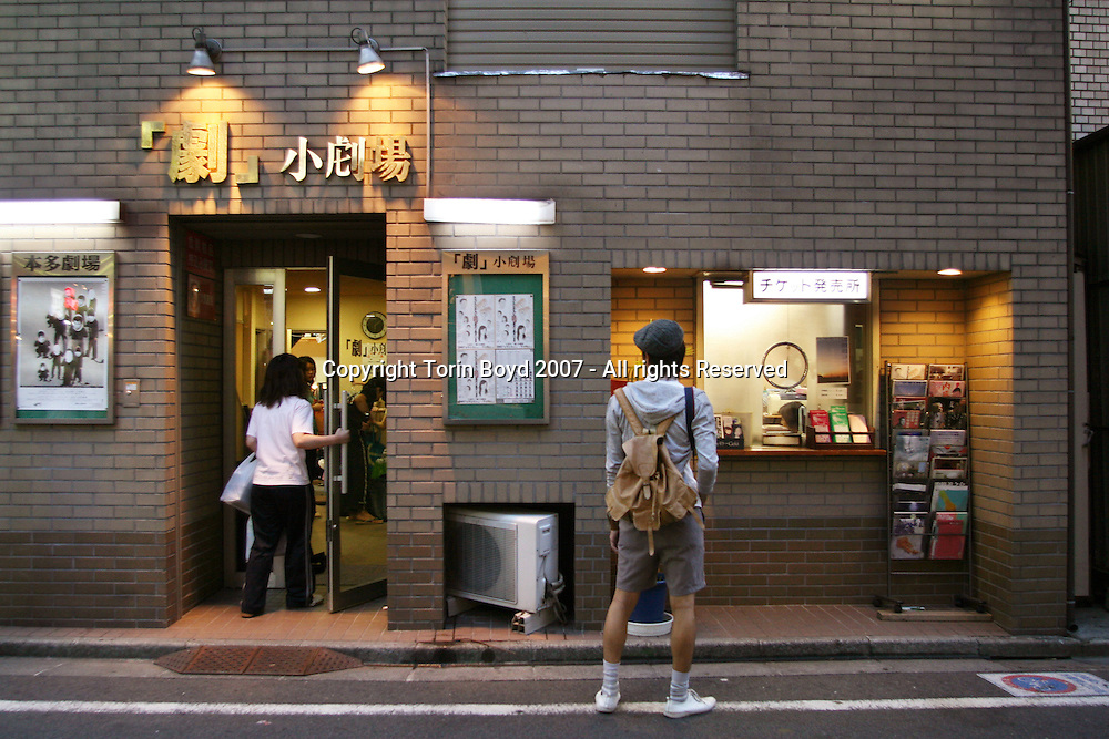 "This is ""Geki Sho-Gekijo"" a small independent playhouse located in the Shimokitazawa district of western Tokyo. These types of playhouses called ""sho gekijo"" which literally means small theater are the domain of amateur theatrical troupes and have gained quite a following in Tokyo. Geki Sho-Gekijo has been in operation since September, 1997. It is also part of a clusters of sho-gekijo in Shimokitazawa which also includes; Honda Gekijo, Off Off Theater, Ekimae Gekijo and The Suzunari..."