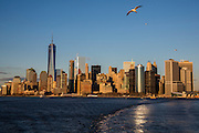 Lower Manhattan, also know as Downtown Manhattan is the financial district and centre for business, culture and government in the city of New York, United States of America.  Photographed in Upper Bay from the Staten Island Ferry at sunset, 27th January 2016. (photo by Andrew Aitchison / In pictures via Getty Images)