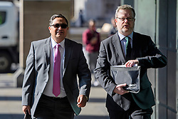 ©  London News Pictures. 28/04/2016. London, UK. BIMLENDRA JHA, CEO of TATA Steel (left)  arrives at Portcullis House in London to give evidence to the Commons Business Committee on the future of British steel. TATA Steel. The future of Tata Steel has been in doubt since it announced it would sell its loss-making UK business. Photo credit: Ben Cawthra/LNP