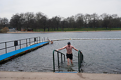 Members of the Serpentine Swimming Club brave the cold for an early morning swim...Matthew Hanney shivers on exit,  London, UK, 25 March, 2013. Photo by: i-Images..