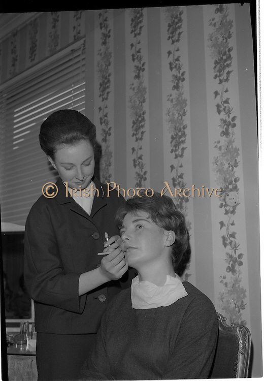 09/03/1964<br /> 03/09/1964<br /> 09 March 1964<br /> Coty Demonstration at Brown Thomas  and Co., Grafton Street, Dublin. Miss Jane Evans a Coty Beauty Consultant would give two cosmetics demonstrations daily for a fortnight to groups of girls from Dublin Schools. Picture shows Miss Evans (left) putting the finishing touches to one of the teenage girls attending the demonstration.
