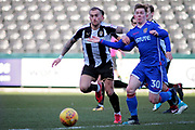 Notts County's Lewis Alessandra(7) and Stevenage striker Mark Mckee (30) tussle during the EFL Sky Bet League 2 match between Notts County and Stevenage at Meadow Lane, Nottingham, England on 24 February 2018. Picture by Nigel Cole.