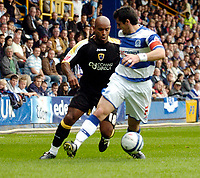 Photo: Leigh Quinnell.<br /> Queens Park Rangers v Cardiff City. Coca Cola Championship. 18/08/2007. Cardiffs Trevor Sinclair slots the ball between the legs of QPRs Adam Bolder.