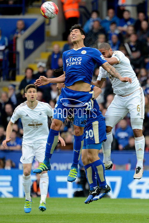 Swansea City defender Ashley Williams beats Leicester City forward Leonardo Ulloa to a header during the Barclays Premier League match between Leicester City and Swansea City at the King Power Stadium, Leicester, England on 24 April 2016. Photo by Alan Franklin.