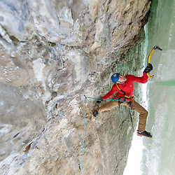 Aaron Mulkey climbing the mixed route Superfly, M8, in Pilot Creek, Wyoming