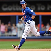 Kirk Nieuwenhuis, New York Mets, runs the bases after hitting the game winning here run homer during the New York Mets V Chicago Cubs Baseball game at Citi Field, Queens, New York. USA. 15th June 2013. Photo Tim Clayton