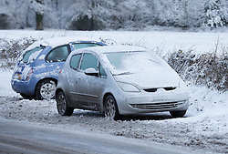 Licensed to London News Pictures. 13/01/2017. Warlingham, UK. Abandoned cars are seen in a layby on an icy country lane near Botley Hill in Surrey today (13/01/2017) after heavy snowfall hit parts of the UK yesterday. Some drivers were forced to abandon their vehicles after rural roads became impassable. Photo credit: Matt Cetti-Roberts/LNP