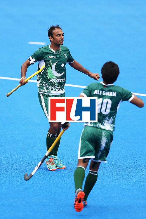 LONDON, ENGLAND - JUNE 25: Muhammad Umar Bhutta of Pakistan celebrates scoring his sides second goal with Ali Shan of Pakistan during the 7th/8th place match between Pakistan and China on day nine of the Hero Hockey World League Semi-Final at Lee Valley Hockey and Tennis Centre on June 25, 2017 in London, England.  (Photo by Steve Bardens/Getty Images)