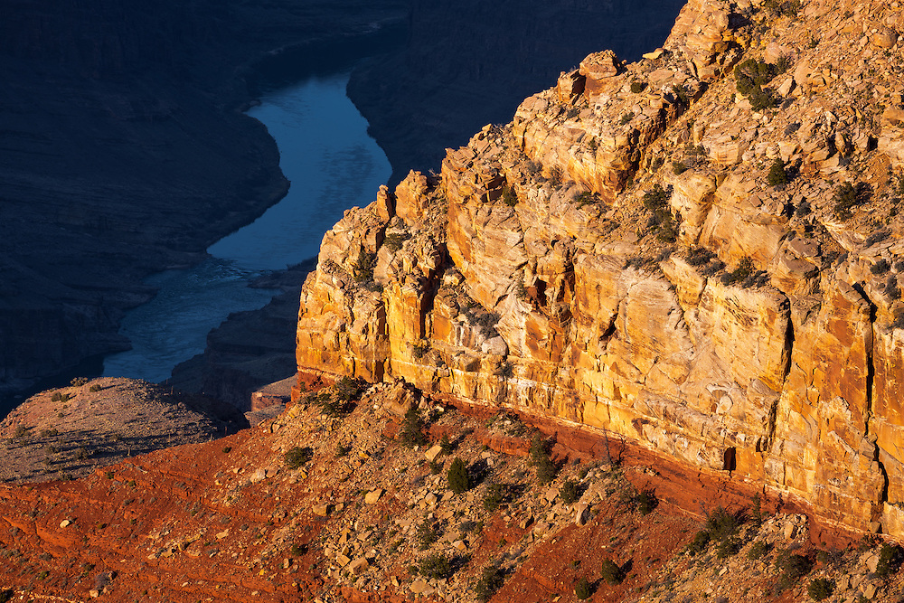 The Colorado River gliding through the sadowy depths of the Grand Canyon.