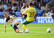 Picture by Chris Donnelly/Focus Images Ltd. 07500 903009 .17/9/11.Ivan Klasnic of Bolton and Kyle Naughton of Norwich clash during the Barclays Premier League match at Reebok stadium, Bolton.