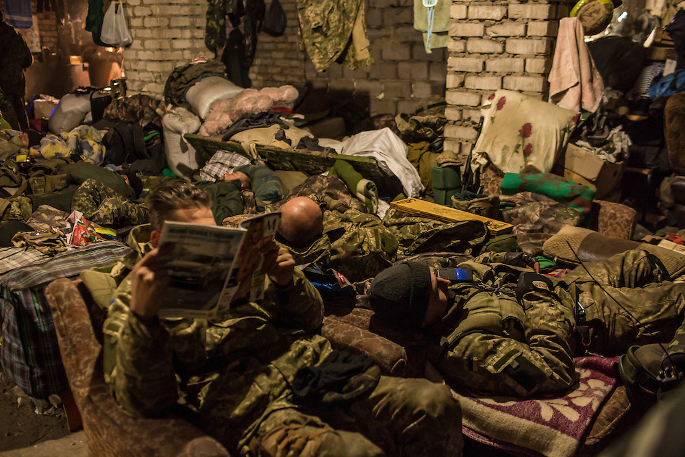 PISKY, UKRAINE - NOVEMBER 17, 2014: Members of the Ukrainian army rest inside the abandoned building being used as their base in the fight against pro-Russia rebels for control of the Donetsk airport, in Pisky, Ukraine. CREDIT: Brendan Hoffman for The New York Times