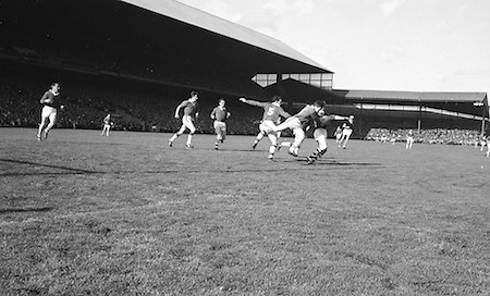 Players tackle during the All Ireland Senior Gaelic Football Final Cork v. Meath in Croke Park on the 24th September 1967.<br />
