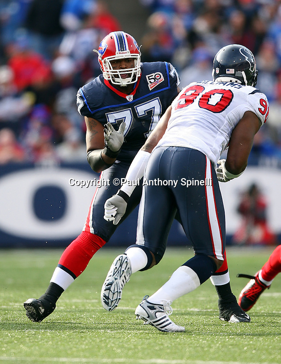 Buffalo Bills offensive tackle Demetrius Bell (77) makes a move to block Houston Texans defensive end Mario Williams (90) during the NFL football game against the Houston Texans, November 1, 2009 in Orchard Park, New York. The Texans won the game 31-10. (©Paul Anthony Spinelli)