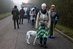 Denham, UK. 6 February, 2020. Environmental activists from Save the Colne Valley, Stop HS2 and Extinction Rebellion walk at a snail's pace along a road so as to block for several hours a security vehicle and truck delivering fencing and other supplies to be used for works associated with the HS2 high-speed rail link close to the river Colne at Denham Ford. Works planned in the immediate vicinity include the felling of trees and the construction of a Bailey bridge, compounds and fencing, some of which in a wetland nature reserve forming part of a Site of Metropolitan Importance for Nature Conservation (SMI).