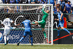 August 21, 2010; Santa Clara, CA, USA;  San Jose Earthquakes goalkeeper Jon Busch (18) makes a save during the first half against the Los Angeles Galaxy at Buck Shaw Stadium.