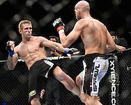 "SYDNEY, AUSTRALIA, FEBRUARY 27, 2011: Curt Warburton (left) kicks the legs of Maciej Jewtuszko during ""UFC 127: Penn vs. Fitch"" inside Acer Arena in Sydney, Australia on February 27, 2011."