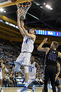 Nov 15, 2017; Los Angeles, CA, USA; UCLA Bruins forward Gyorgy Goloman (14) shoots the ball as Central Arkansas Bears forward Tanner Schmit (22) defends during a NCAA basketball at Pauley Pavilion. UCLA defeated Central Arkansas 106-101 in overtime.
